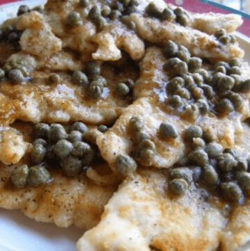Chicken with Brown Butter & Capers on a serving platter.