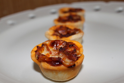 Finished pizza pie bites on a serving platter.