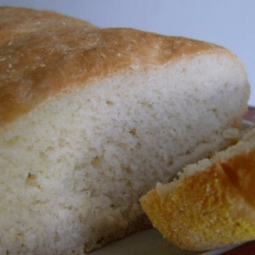 Loaf of english muffin bread with a slice cut off