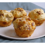 4 bacon and cheese muffins on a white plate