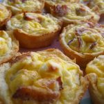 Bacon cheese and egg biscuit cups on a platter