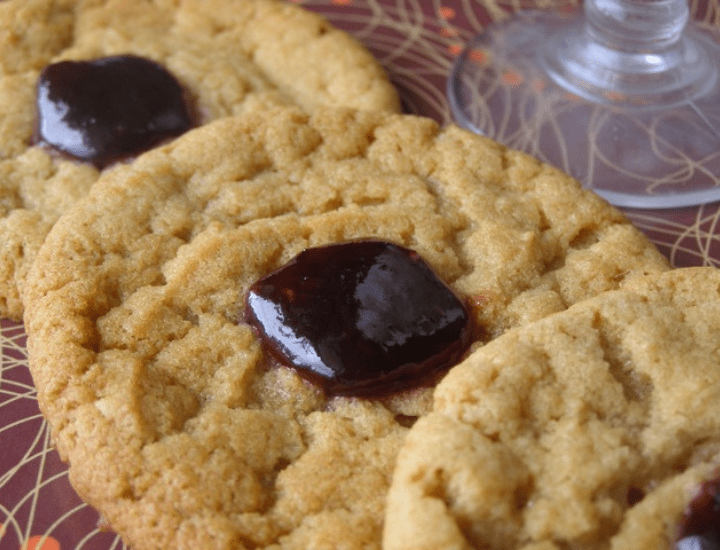 Close up of peanut butter jelly thumbprint cookies